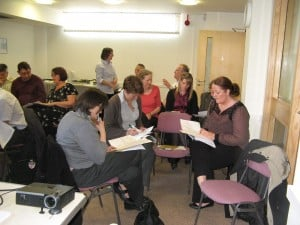 Attendees at Yorkshire LCA training session working on practical exercise with our trainer, Nicola Hodgson, standing.