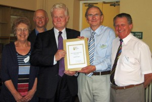 Tim Crowther (2nd from right) presents the certificate to (from left) Lyn, Ryan, John Moorby, Trevor Dean and Dave Wainman of Grange Area Trust
