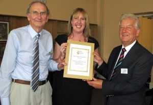 Tim Crowther (left) presents the certificate to Laura Richardson of Elmbridge Borough Council and David Tipping of Cobham Conservation & Heritage Trust