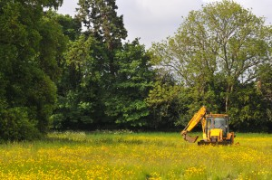 A digger poised to destroy historic grazing land at Thame.  The site has been allocated for destruction and development in the town's neighbourhood plan.  Photo: Richard Jeffries