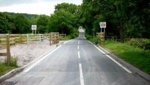 The fencing runs beneath the road to avoid the need for a cattle-grid