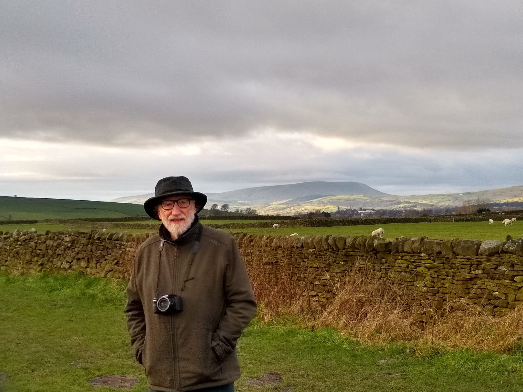 Tony on Trawden recreation ground with Pendle Hill behind, Christmas day family meet-up outdoors, 2020