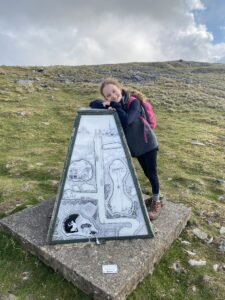 Patricia at a capped mineshaft on Bakestonedale Moor. The artwork depicts the local mining activity. Image John Rogers